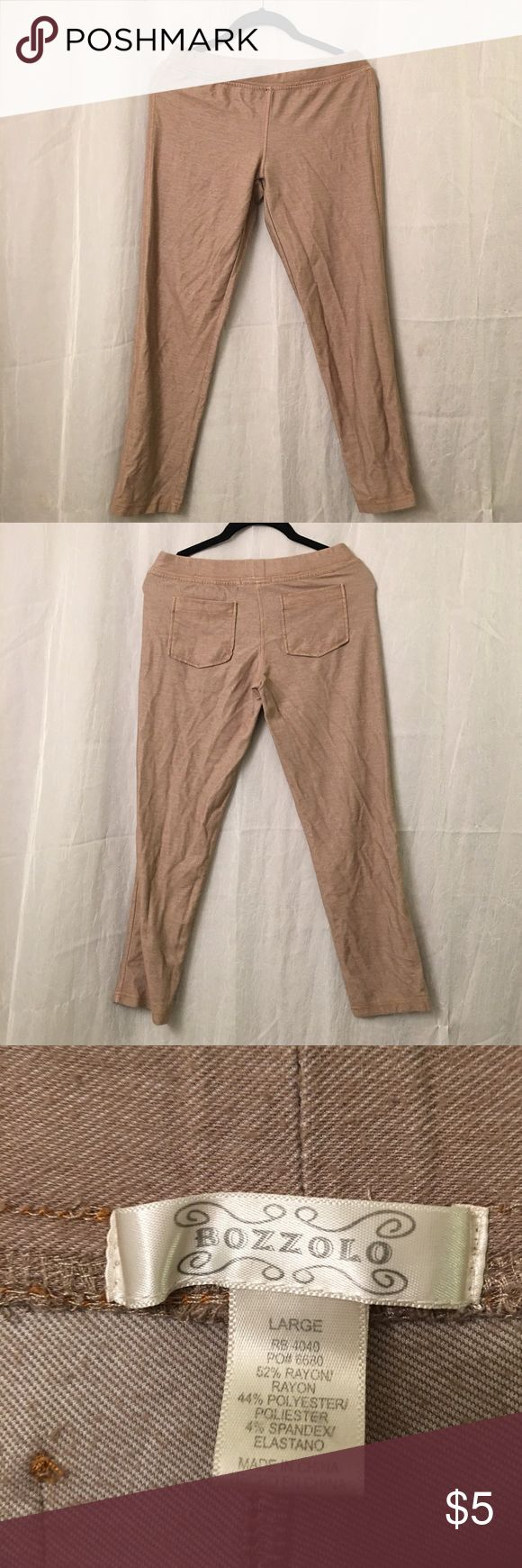 Beige tan nude leggings A pair of beige/tan/nude leggings with back pockets! Good condition just has some fuzzies on it that I can't get off with a lint brush. I don't like nude colored clothing :/ bozzolo Pants Leggings