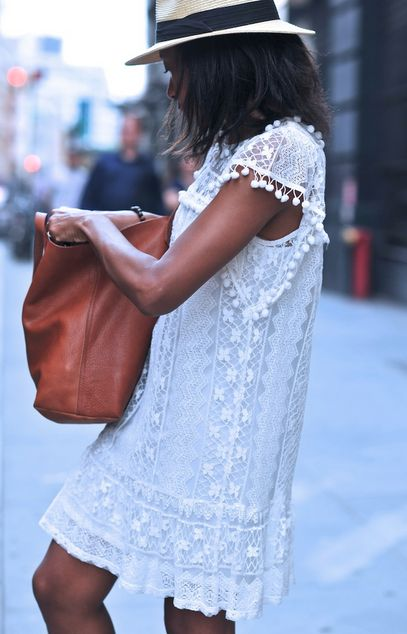 Big slouchy brown bag and lacy white dress-love!