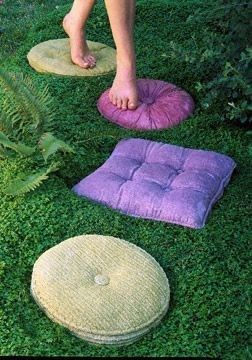 Concrete stepping stones that look like vintage pillows. Get old pillows, lather with petroleum jelly, cover with plaster of paris. once hardened, remove pillow and fill mold with concrete!