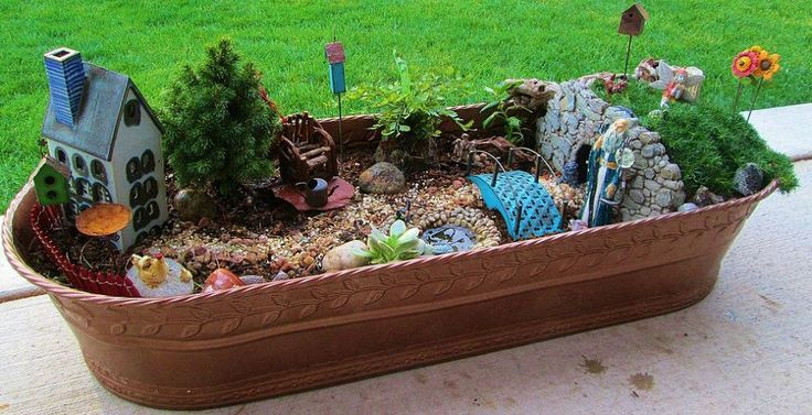 May...... do something like this for creative play and plant flowers and expand from this.