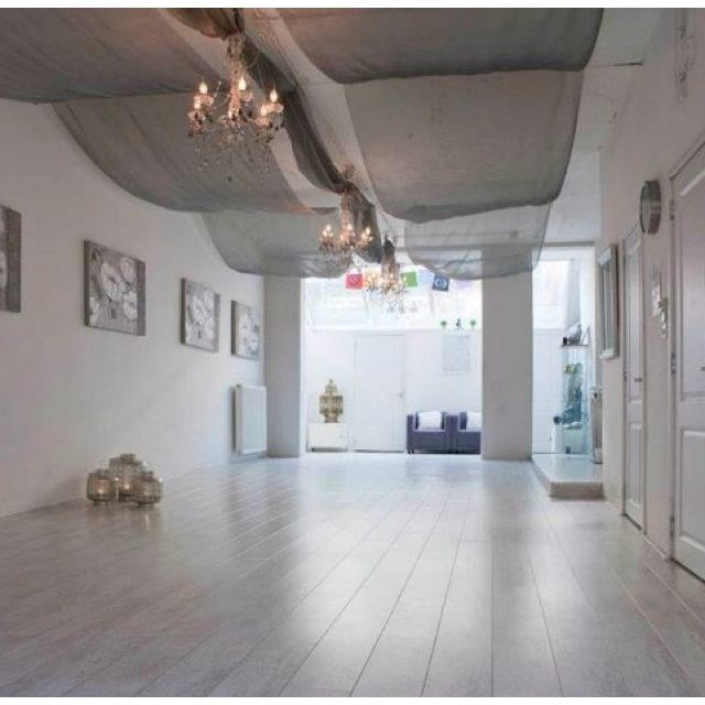 Yoga studio @ Inner Energy Shop ~ love the fabric above and chandeliers and…