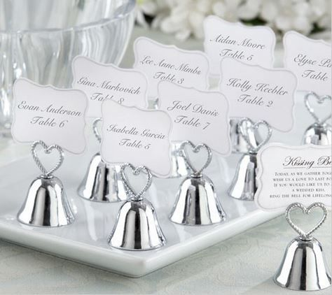 """Happiness is like a kiss. It feels best when you give it to someone else. With our """"Kissing Bell"""" place card/Photo Holder wedding favor, give your guests and yourselves the pleasure of reliving the moment over and over again. A sweet poem on the back of the place cards invites guests to """"ring"""" fo..."""