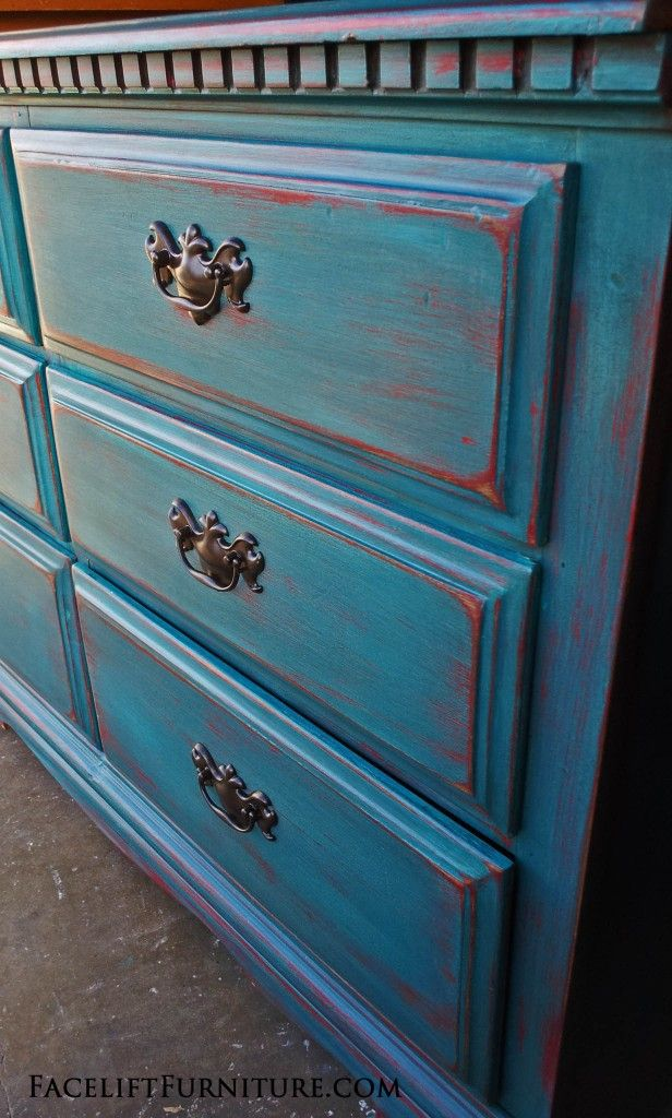 Dresser in Peacock Blue distressed down to Red. Facelift Furniture DIY Blog.