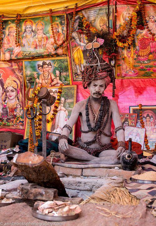 kumbh mela - Naga Sadhu sitting at his dhuni