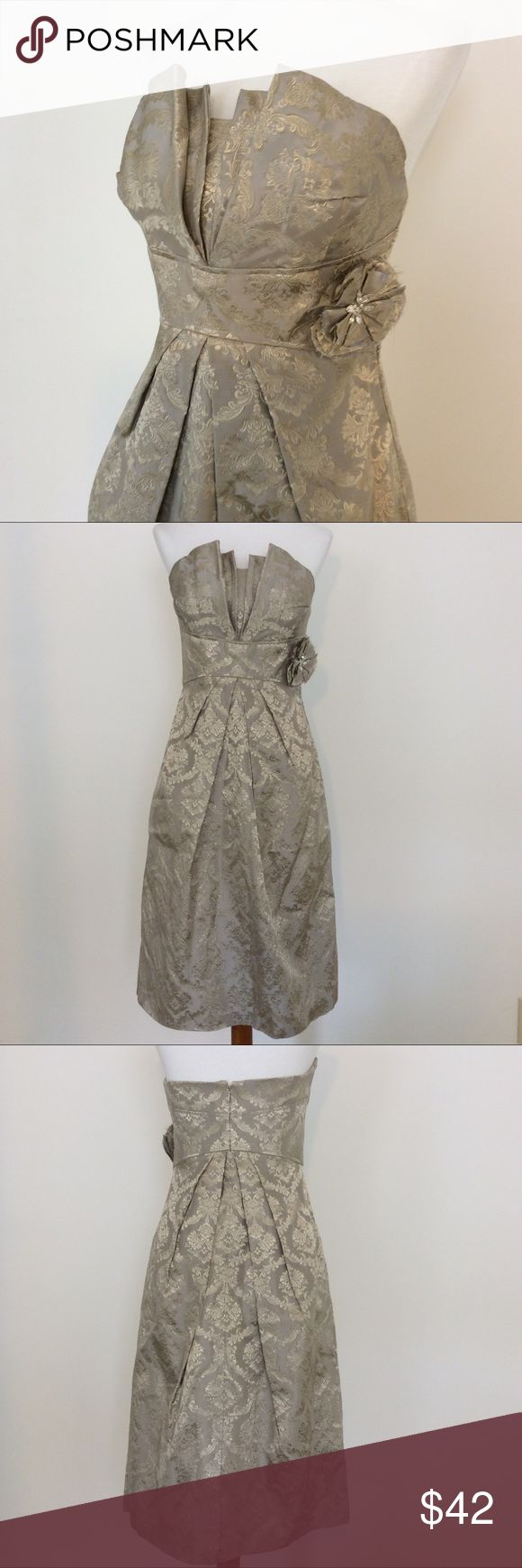 Watters & Watters Metallic Brocade Dress 6 Stunning metallic strapless dress by Watters & Watters. Size 6. Detachable floral pin. Great condition. Perfect for a wedding guest! Watters & Watters Dresses Strapless