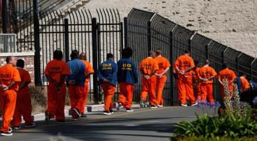 Inmates walk in file at San Quentin State Prison. (Credit: Gary Coronado / Los Angeles Times)