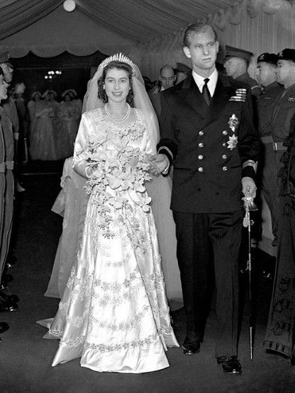At her wedding to Prince Phillip, the Duke of Edinburgh, Queen Elizabeth II wore a silk and embroidered gown with crystals and 10,000 seed pearls, with a 13 feet train gown, designed by Norman Hartnell.