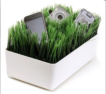 Tidy charging. At the moment all my wires trail across the kitchen work surface. Everything is he'd neatly in the tray and the ends poke up through the artificial grass, so your phone / camera/ iPod can be charged in style. My favourite of the day me thinks!