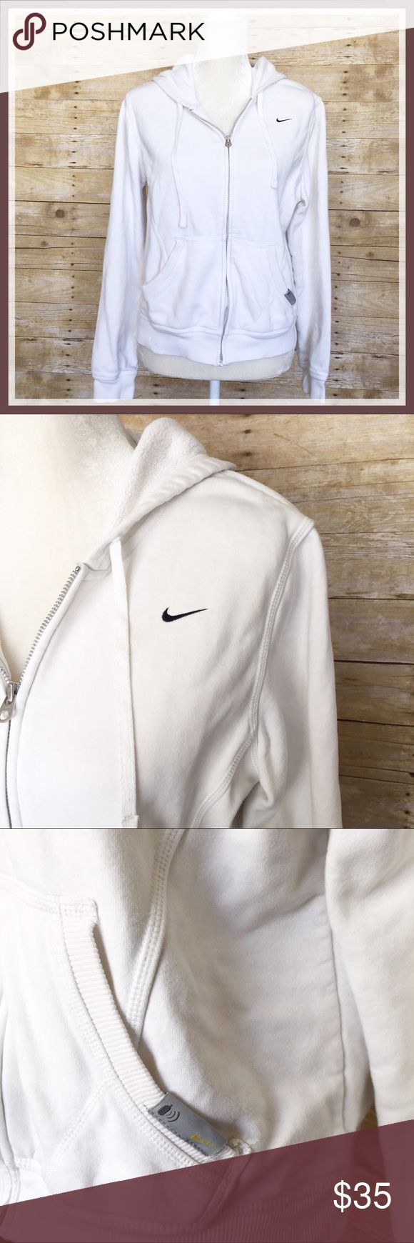 Nike White Zip Up Hoodie Audio Sweatshirt Nike white zip up hoodie. Size large, slimmer fit. Audio pocket kangaroo pouch on front. Some fuzzies on inside lining, as normal with prior light use, but is in excellent condition. Bust measures 20 inches and length is 21. Thanks so much for looking! Nike Tops Sweatshirts & Hoodies