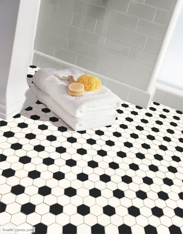 Subway tile...love it against this flooring in the bathroom. Perfect for a kids bathroom.