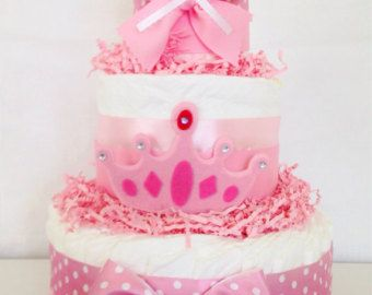 *** ***MINIMUM OF 3 MINI DIAPER CAKES PER ORDER***  This Sparkly Mini Princess Baby Shower Diaper Cake would make a stunning display at the upcoming Gold and Pink Princess Baby Shower! Display as the Centerpieces at each guest table for a one-of-a-kind decoration! Each Mini Diaper Cake includes 11 Pampers Swaddlers Diapers in size 1 and is designed using quality ribbons and bows and a handcrafted gold crown.