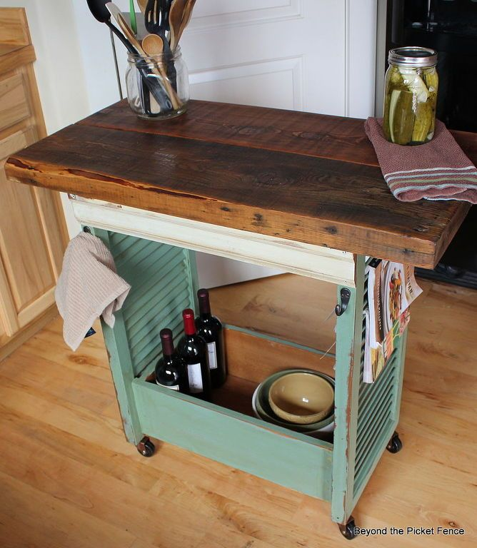 s 19 incredible kitchen islands made from totally unexpected things, kitchen design, kitchen island, repurposing upcycling, From spare shutters to a cute rolling island
