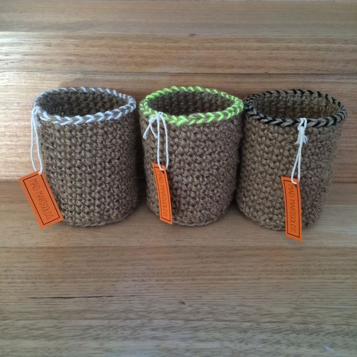These containers are crocheted from heavy stringy jute twine, each with a feature trim of acrylic wool.  They measure about 12cm high by 10cm in diameter.Perfect to help organise your desk or craft space. Also a great gift idea.  It would be a great little motivation gift for someone starting a new job or university. These containers are ready to ship within 3 working days.