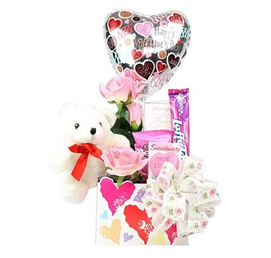 """Did someone order a tall order of romance? Your significant other will adore the caring sentiment behind the """"Who Loves Ya Baby!"""" Valentine's Day Gift Basket."""