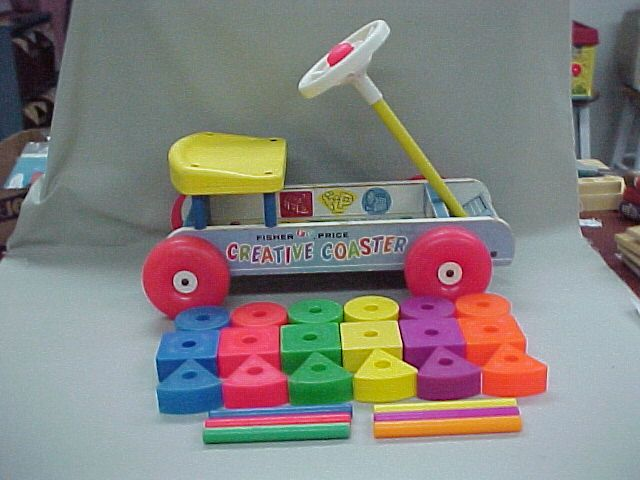 Fisher Price Creative Coaster came with plastic blocks and dowels. When the wheels rolled you ...