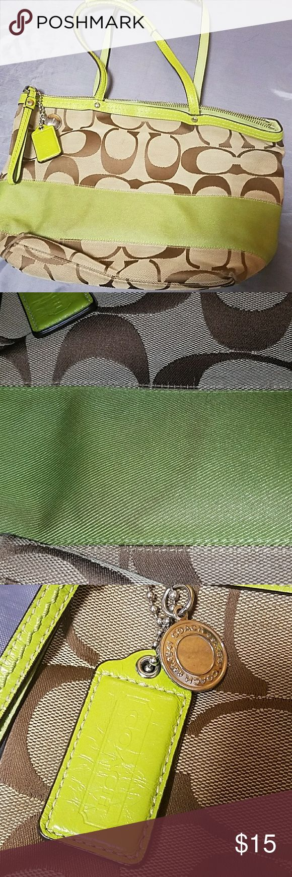 Coach tote purse Used brown and green coach purse. Signature C's all over. Has brown stain on green stripe and fabric is a bit worn. Inside has pen marks a plenty. May just need to be cleaned but i havent tried Coach Bags Shoulder Bags