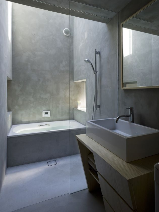 Concrete wall and floor finishes in this Japanese house - Beautifully done with glass and wood.