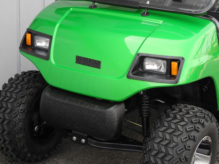 This 2000 Yamaha G16 custom street-ready gas golf car has a freshly-painted Electric Green body, 4-inch lift kit, new black seat covers, diamond plate trim, premium lights, folding windshield, horn, 5-panel rear view mirror, license plate bracket, rear flip seat, Line-X hard top, and 20-inch tires on 10-inch aluminum wheels for $4590.  #Yamaha #G16 #customgolfcar #gasgolfcar #forsale #streetready #green #PES #PowerEquipmentSolutions #Vandalia