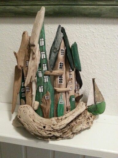 Lille drivtømmer by. Small driftwood town/houses with seaglass.  By EVAS.