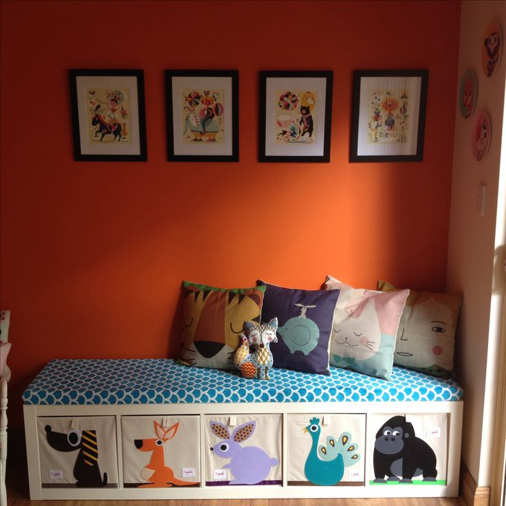 My little girls play room - Helen dardik pictures. Ikea expedit bookshelf with 3 sprouts storage cubes. My dad & I made the bench pad from wood & foam using a staple gun. Cushions from etsy