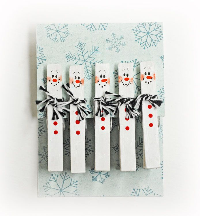 D.I.Y. Snowman Clothespins. Could add a magnet to back
