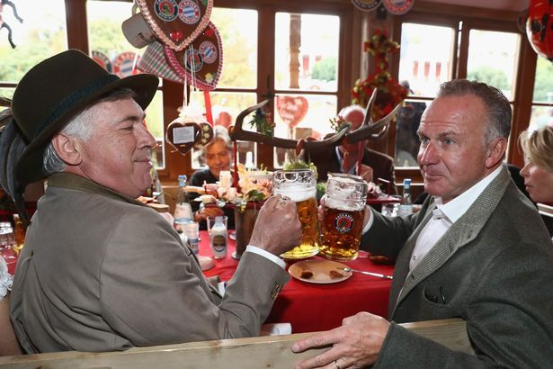 Carlo Ancelotti and CEO Karl-Heinz Rummenigge
