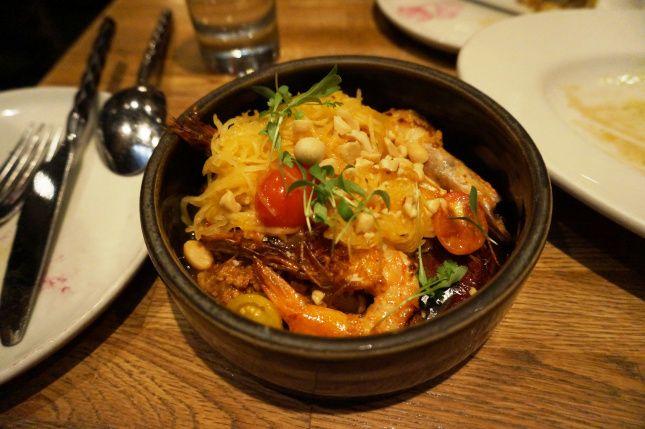 Sauteed shrimp with peanut-pork ragout, spaghetti squash, grape ...