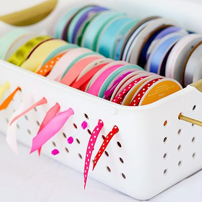 Safely store your ribbon in a simple storage basket, only $1 at Dollar Tree! You'll be able to keep track of your ribbon while saving space — it's a win-win situation.