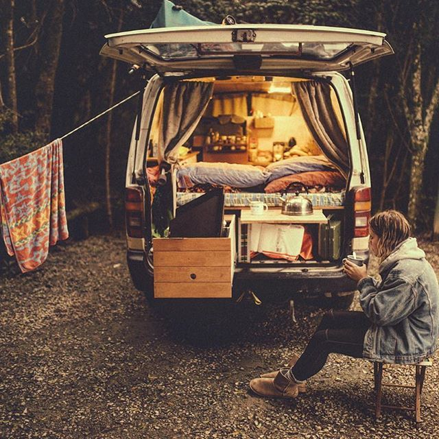 Slide out kitchen with fold up bench as the door for the other storage area. Rolling out of bed is worthwhile when you; watch the sunrise whilst running on the beach, cool off with a salty swim in the ocean  and then come back for some delicious breakfast in your slide out kitchen ☕️ #vanlifediaries                      // Photo by @mitch.cox