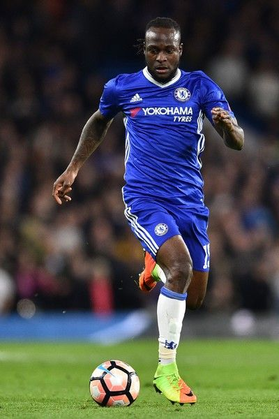 Chelsea's Nigerian midfielder Victor Moses runs with the ball during the English FA Cup quarter final football match between Chelsea and Manchester United at Stamford Bridge in London on March 13, 2017. / AFP PHOTO / Glyn KIRK / RESTRICTED TO EDITORIAL USE. No use with unauthorized audio, video, data, fixture lists, club/league logos or 'live' services. Online in-match use limited to 75 images, no video emulation. No use in betting, games or single club/league/player publications.  /