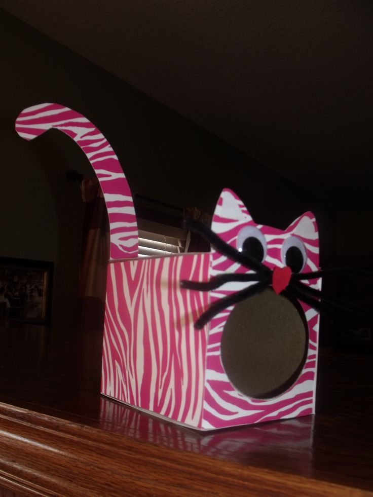 Emmy's Valentine's Box made from a klenex box covered with pink and white zebra print paper.