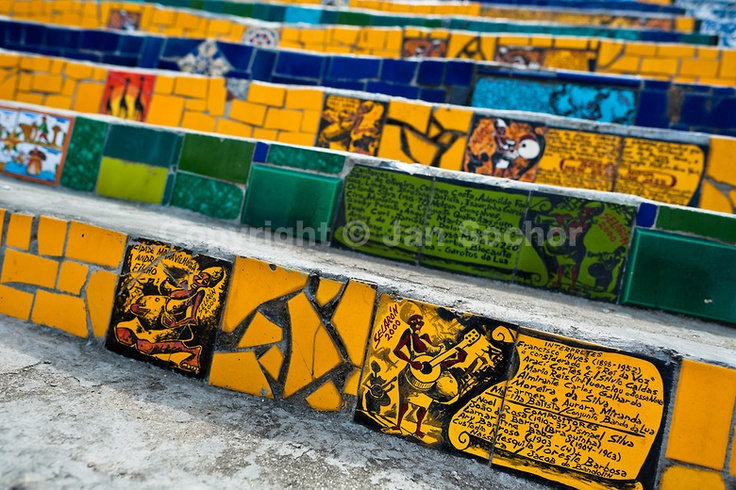 View of hand painted tiles on Selaron's Stairs (Escadaria Selarón), a mosaic staircase made of colorful tiles, in Rio de Janeiro, Brazil, 12 February 2012. World-famous staircase, mostly covered by vibrant yellow, green and blue tiles (inspired by the colors of the Brazilian flag), is the masterpiece of Chilean-born artist Jorge Selarón who considers it as a personal tribute to the Brazilian people. Connecting the neighborhoods of Santa Teresa and Lapa, the stairway is made up of 250 steps…