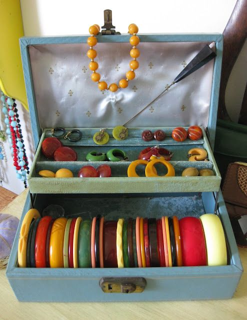 I have a recurring dream of finding an old jewelry box or little handled-suitcase like this full of old bangles at a garage sale. Keep dreaming Lisa, I think those days are over.
