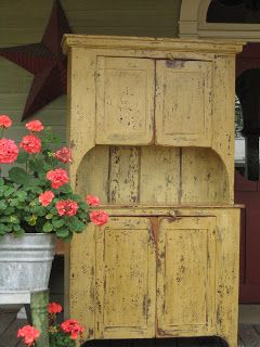 Oh MY......love the worn and weathered cupboard and the tub of posies!!!!!!!!!!!!.