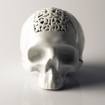 Filigree Skull Money Box by Studio Piršč Porcelain.