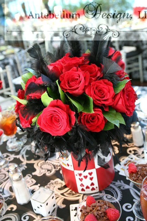 Red and black flower centerpiece with feathers for