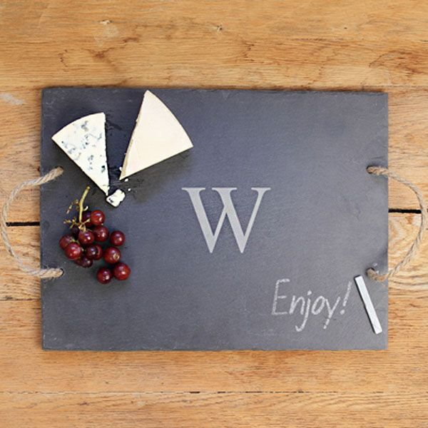 This slate serving board would be perfect for a wine and cheese tasting bridal shower, or even as a hostess or housewarming gift. Pair with wine glasses, coasters, and ceramic tags for labeling the cheeses for a thoughtful gift basket. This serving board can be ordered at http://myweddingreceptionideas.com/engraved-initial-slate-serving-board.asp