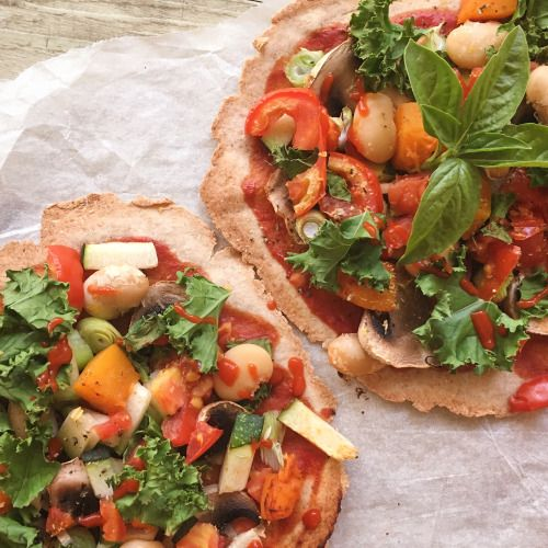 naturallynina:  Homemade cruelty-free pizza is definitely the best kind a crispy buckwheat-spelt base topped with pumpkin, mushroom, tomato, kale, spring onion, zucchini, fresh herbs + nooch   Recipe will be in my upcoming Ebook! x  ( IG: @naturally_nina_ )