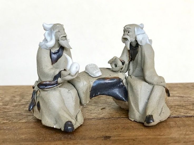 Two bonsai mud men with pipe talking – miniature figurines for bonsai trees