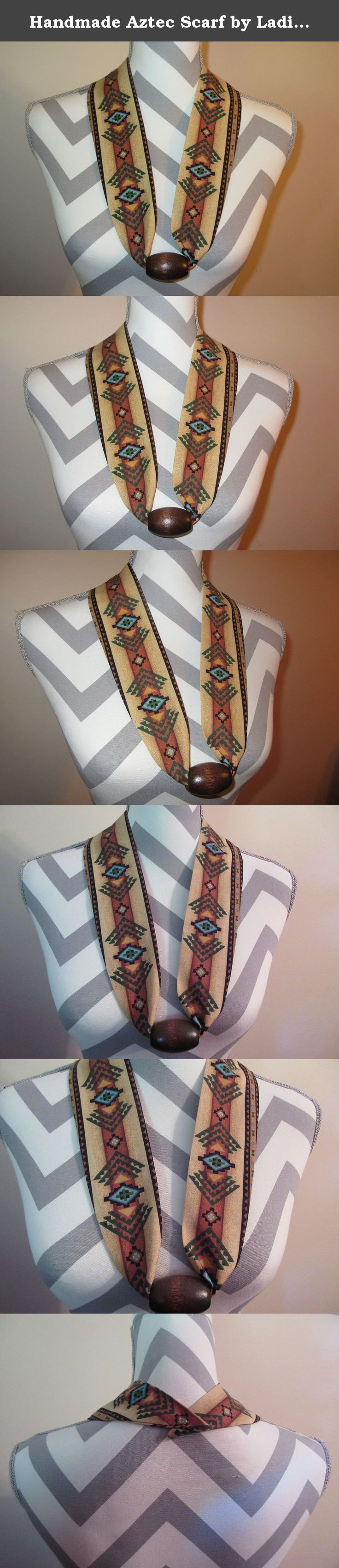 Handmade Aztec Scarf by Ladies Fashion Collars Unique No Tie Southwestern Print Scarf with Wood Brown Bead One Size Fits All Cotton Print Gift for Her with Gift Bag and Ribbon. Handmade Ladies Fashion Collars Fabric Scarf Necklace Aztec Southwestern Cotton Print with a Wood Brown Bead. One Size Fits All; Simply Slip it Over Your Head; Lightweight Only 1 Ounce, Bead holds decorative fabric scarf in place, complementing any neckline. No Tie; No Fuss; No Clasp; Fun and Easy to Wear; Infinity...