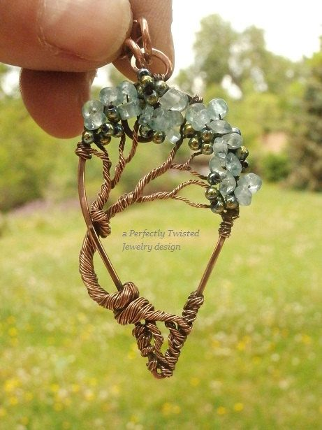 Wire Wrapped Tree of Life Pendant, Aquamarine Gemstones Handmade Jewelry Copper Wire Tree Jewelry March Birthstones, Perfectly Twisted Aquamarine, the birthstone of March, has a rich color and has long been a symbol of youth, health and hope. The pendant is 2 inches in height and approximately 1 inches wide, at the widest point. It comes with a 18 inch solid copper chain. This unique and gorgeous tree of life has a generous canopy of beautiful Aquamarine gemstone beads accented with…