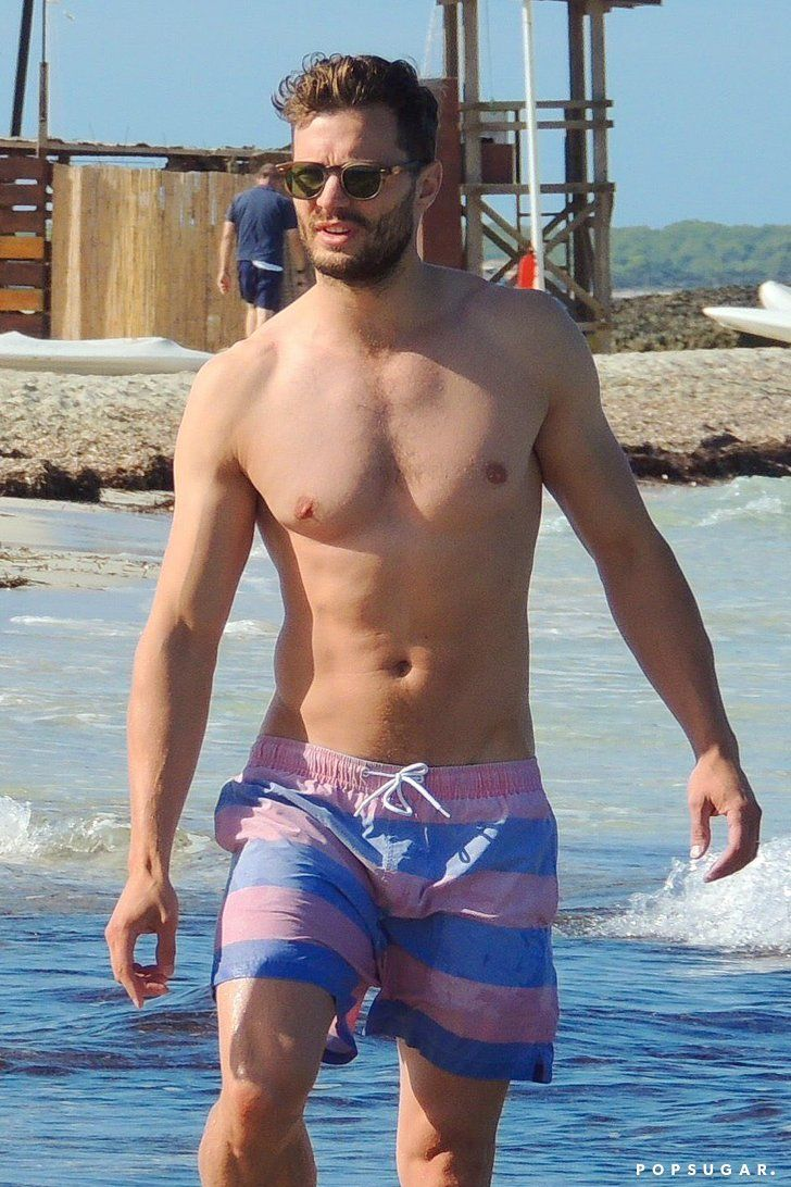 70263d9e8d Shirtless Jamie Dornan Crawling on the Sand Is Sort of Everything ...