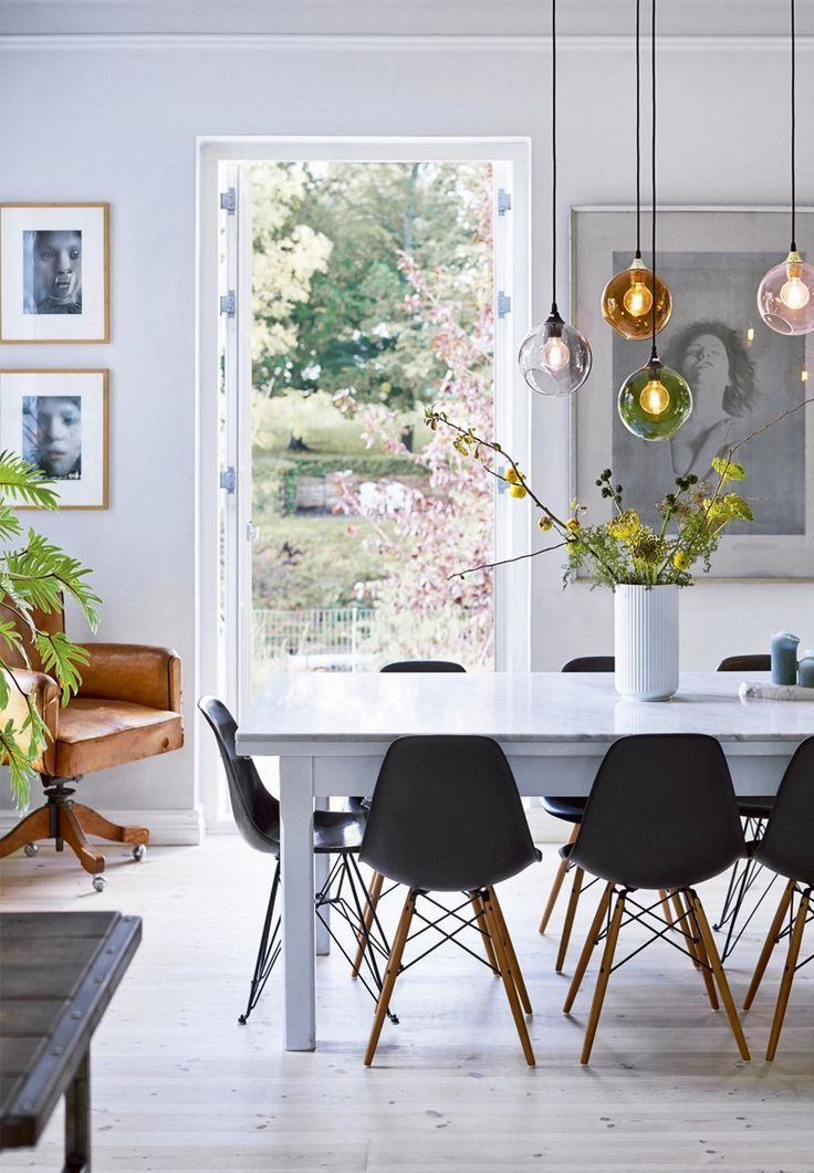 Scandinavian dining room with beautiful flowers and branches from the garden.
