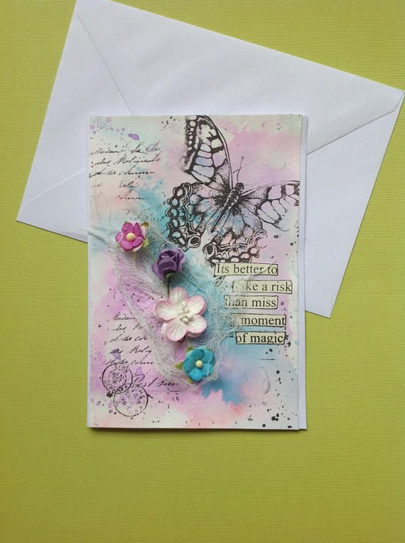 Inspirational handmade card with feminine colors of pink and blue. I usually make 3D cards, this is a real mixed media card.  The butterfly is hand stamped. The really nice text Its better to take a risk than miss a moment of magic is encouraging but gentle. This is also hand