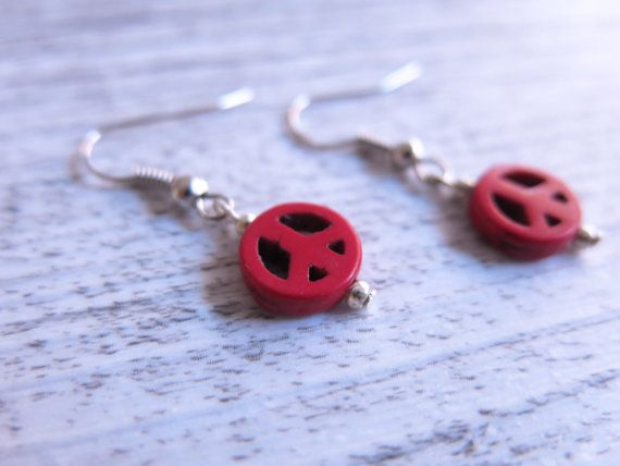 These beautiful earrings feature 1cm red howlite stones carved into peace signs hanging from a silver plated hook earrings.  Howlite is a stone