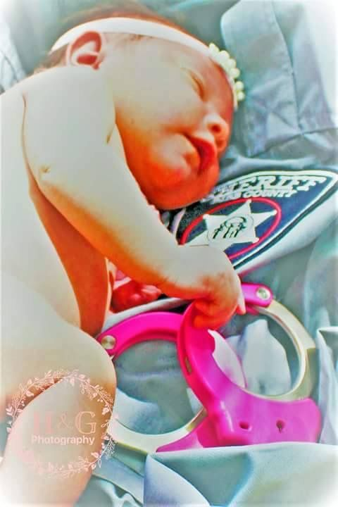 We wanted to share a new picture of our baby girl, Tatiana Skyy Romeo!  This pink bundle of joy was born to Bibb County Sheriff's Office Deputy Misty Romeo in late April and it looks like she's already ready to serve and protect!  (Picture courtesy Deputy Romeo)