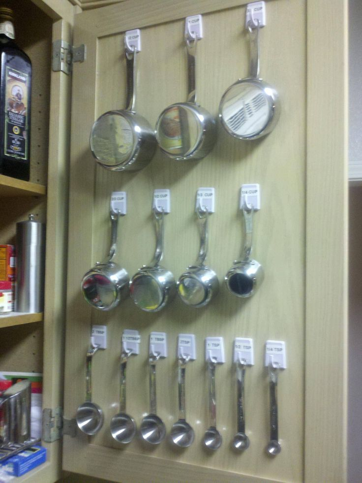 Hang all my measuring cups and measuring spoons using 2 packs of self adhesive hooks from the dollar tree. This might also work for some of the cooking utensils.  May have to consider as I reorganize the kitchen.