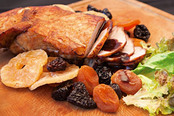 Christmas pork with dried fruit served with golden oven potatoes http://agoragreekdelicacies.co.uk/christmas-recipes/4581460494