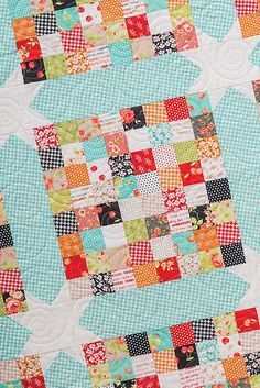 Scrap Happy by Vanessa Goertzen from the book Charm School--18 Quilts from 5'' Squares. Make it with just about anything in your stash--charm packs, mini charms, jelly rolls, layer cakes, fat quarters, scraps, etc. Fabric is Farmhouse by Fig Tree Quilts & Co for Moda Fabrics. Quilting by Abby Latimer.