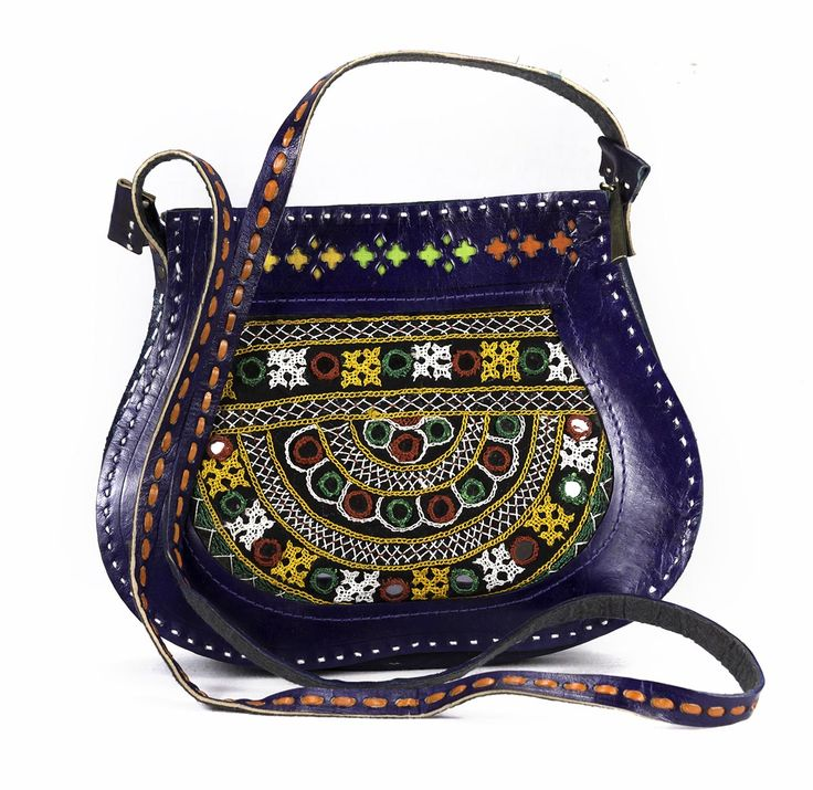 Leather Flap Bag is beautifully decorated with smart flap and silk base with Handel. One zipper enclosure on top and one small zipper pocket inside.